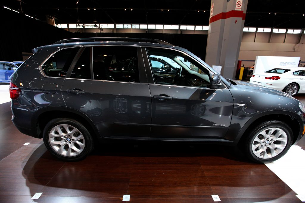 A black 2014 BMW X5 on display at an auto show