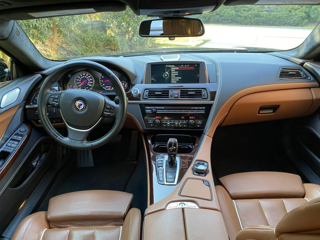 The brown-leather front seats and black dashboard of a 2015 BMW Alpina B6 xDrive Gran Coupe