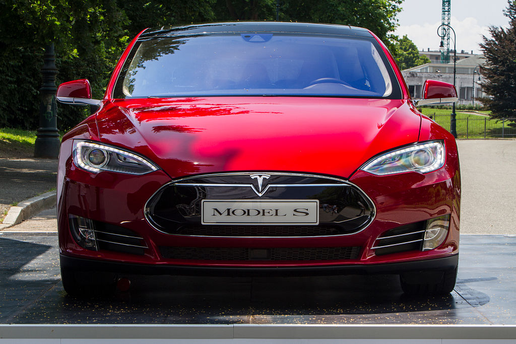 Front-end view of a red 2015 Tesla Model S