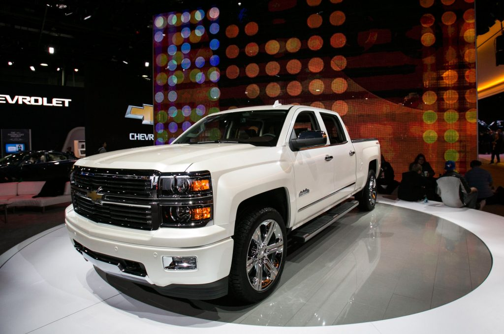 A white 2015 Chevrolet Silverado sits on display at the North American International Auto Show
