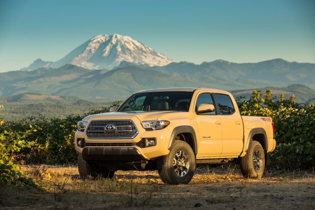2016 Toyota Tacoma parked in front of a mountain