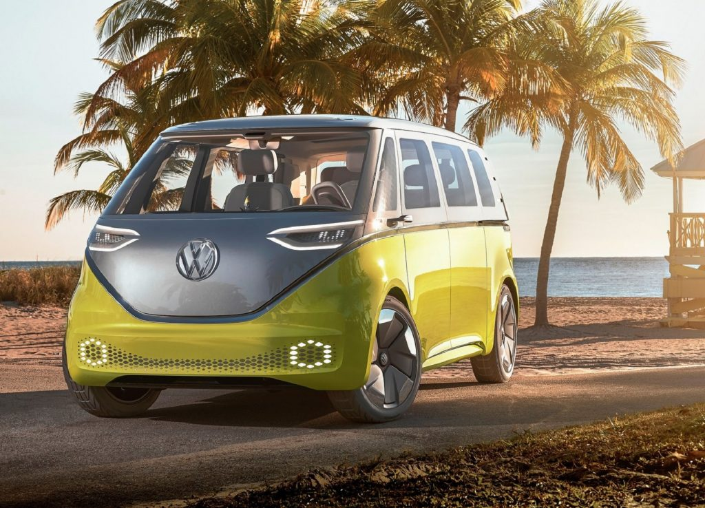 The yellow-and-silver 2017 Volkswagen ID.Buzz Concept parked by a sandy beach