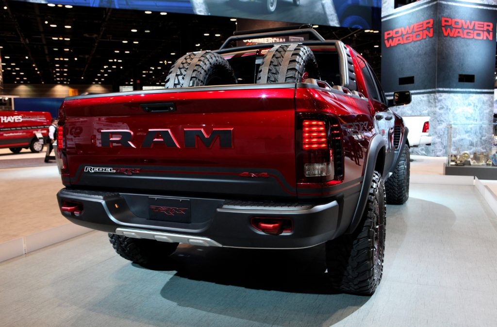 A red 2017 Ram 1500 Rebel TRX 4x4 on display with tires in the trunk