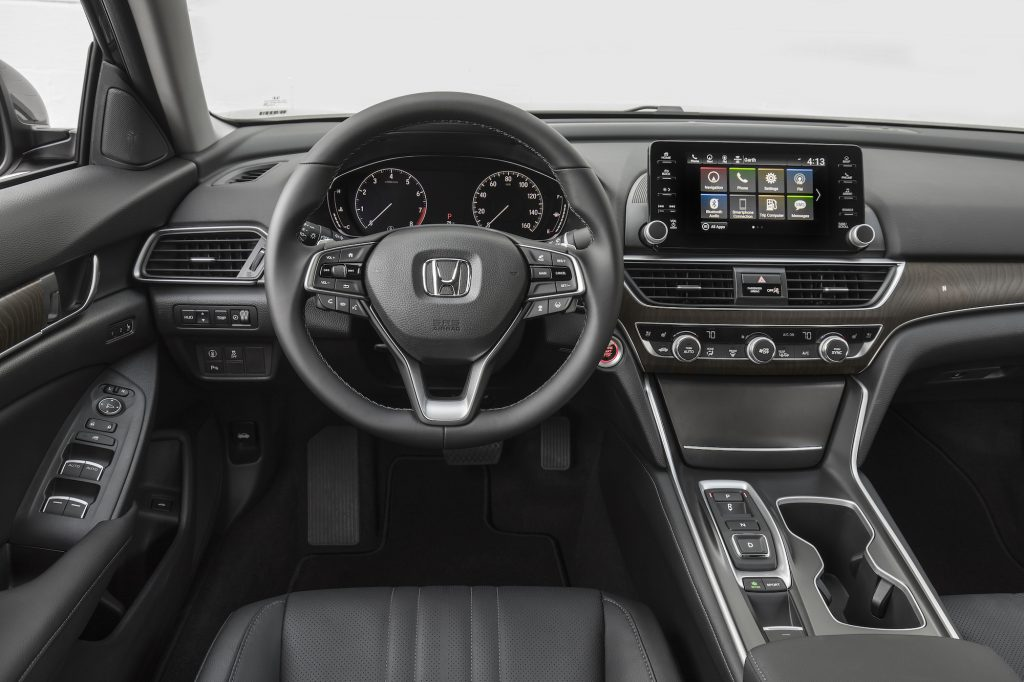 The black cockpit, including the steering wheel, of a 2018 Honda Accord Touring 2.0T sedan
