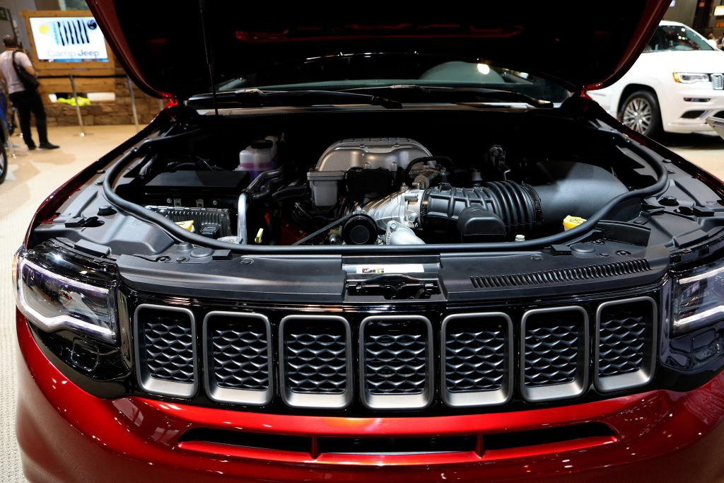 Under the hood of a red 2018 Jeep Grand Cherokee