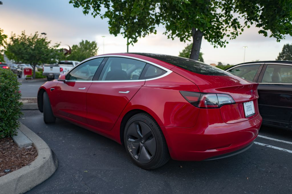 Side view of a red Tesla model 3