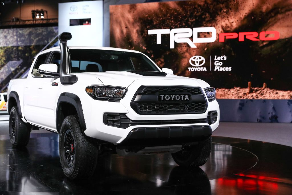 A white 2018 Toyota Tacoma Pickup truck on display