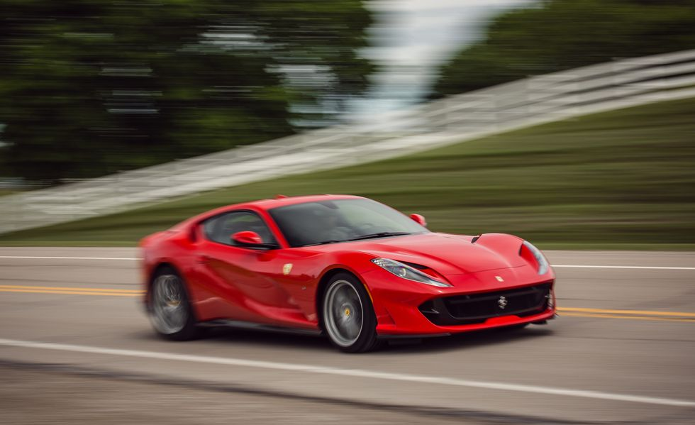 A 2018 Ferrari 812 Superfast accelerating down country road