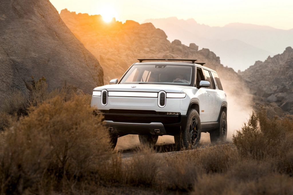 Rivian R1S parked in the desert at dusk