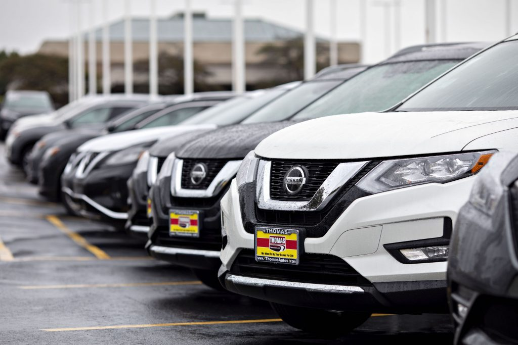A 2019 Nissan Motor Co. Rogue sport utility vehicle (SUV) sits on the lot at a car dealership in Joliet, Illinois