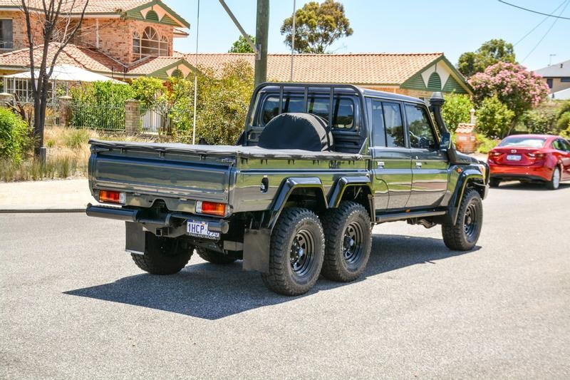 An image of a Toyota Land Cruiser 6x6 parked outside in Australia.