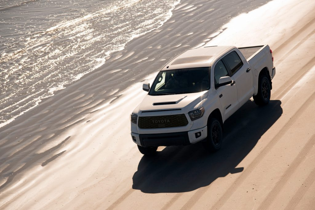 The 2019 Toyota Tundra driving on a beach