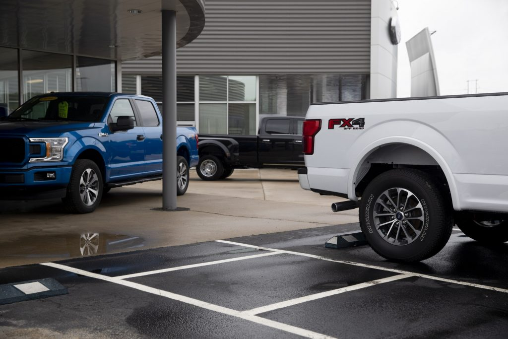 2020 Ford Motor Co. F-150 trucks sit outside the showroom at a car dealership in Peoria, Illinois, U.S.