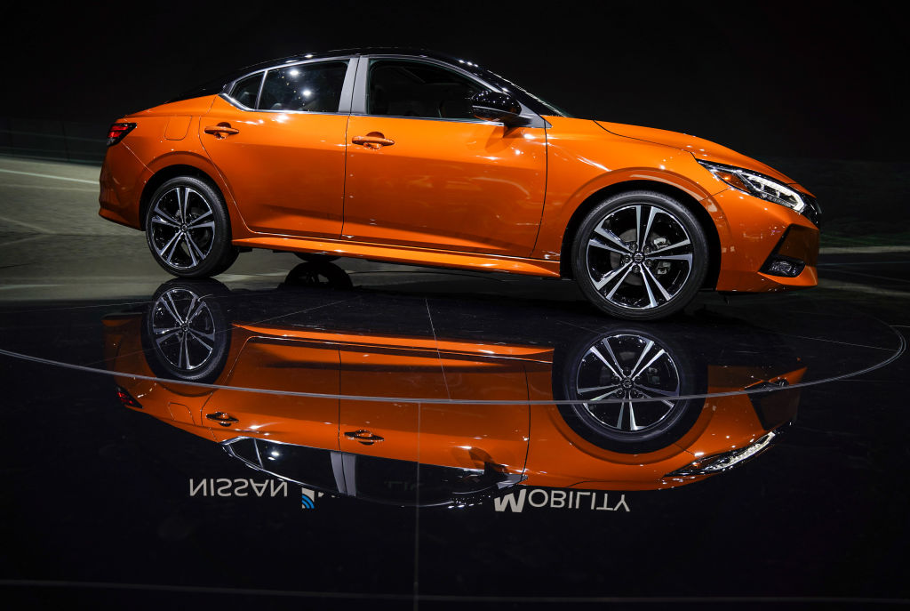 An orange 2020 Nissan Sentra sits on display