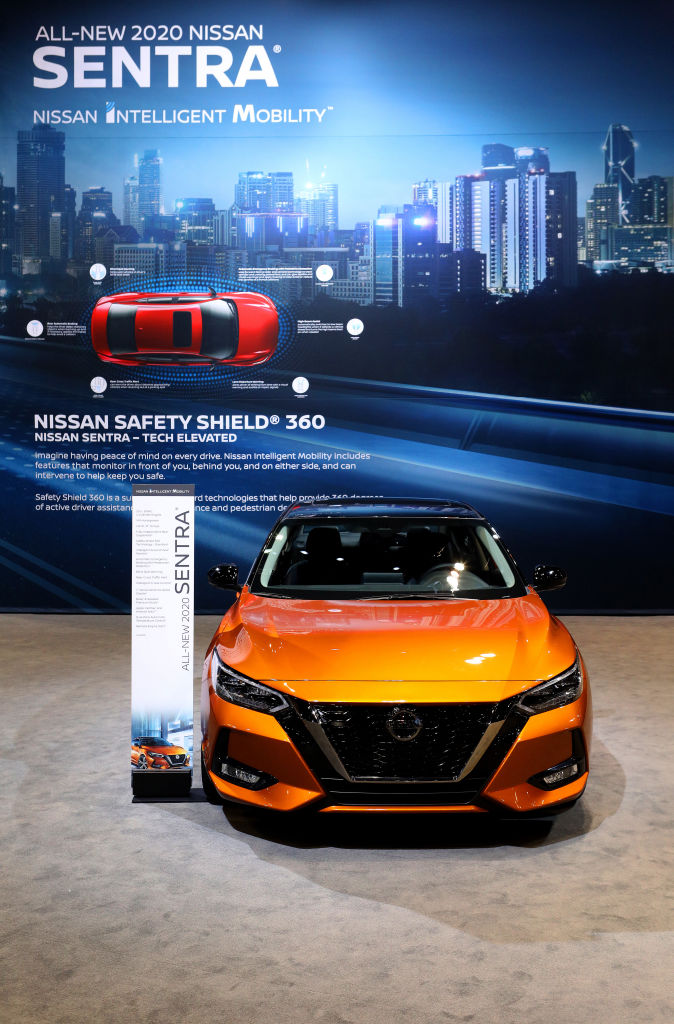 An orange 2020 Nissan Sentra on display pictures from the front