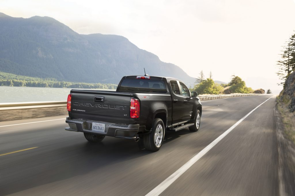 A black 2021 Chevy Colorado Diesel LT driving down a highway road