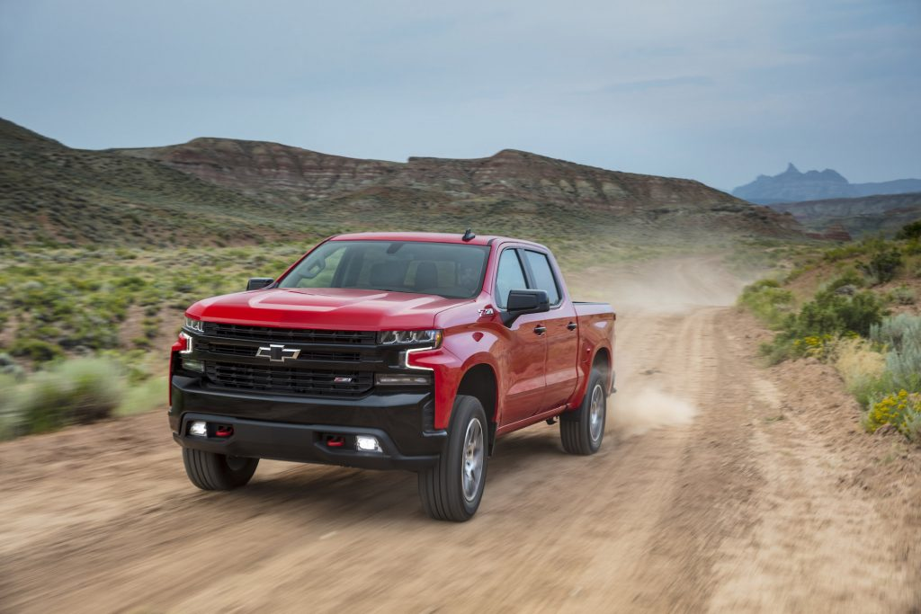An image of a red 2021 Chevrolet Silverado on a dirt road.