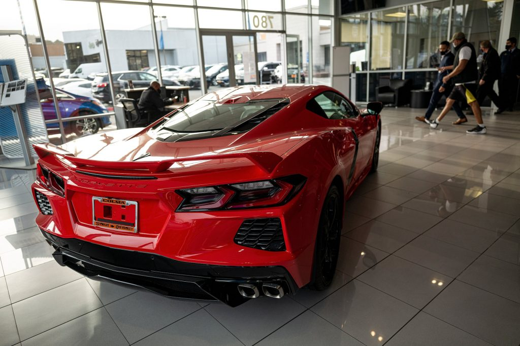 A red 2021 Chevy Corvette sports car parked inside a car dealership in Colma, California, on Monday, February 8, 2021
