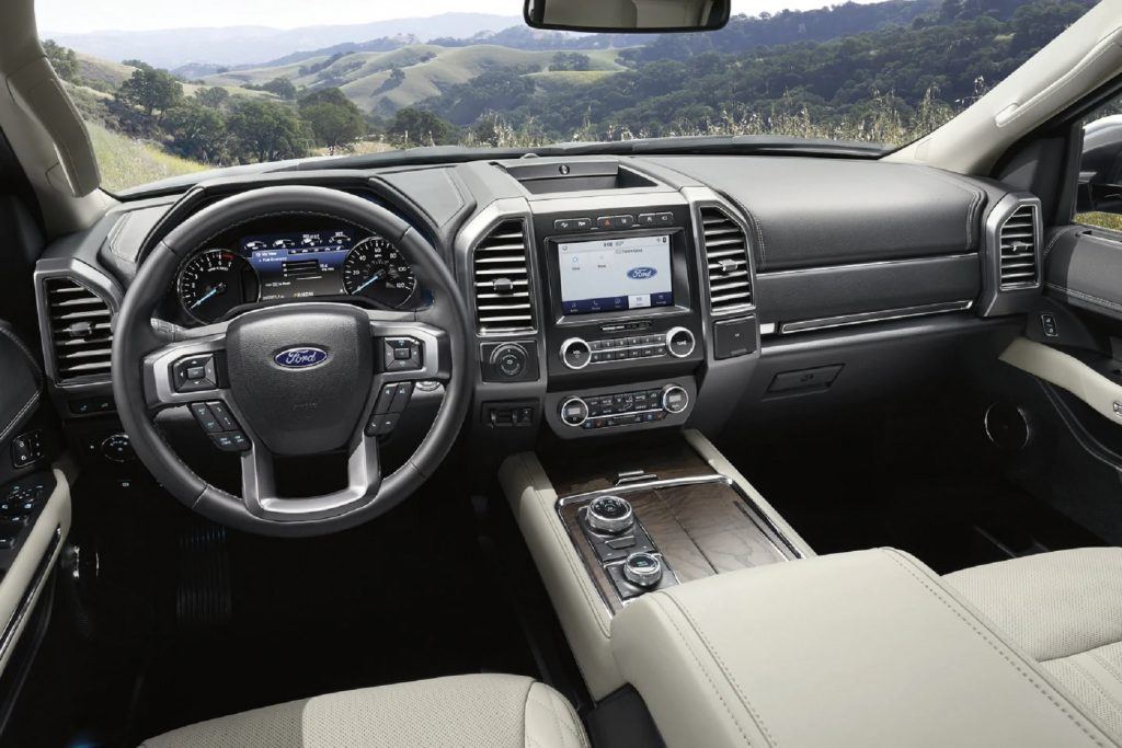 The white-leather and black-leather dashboard of a 2021 Ford Expedition Platinum