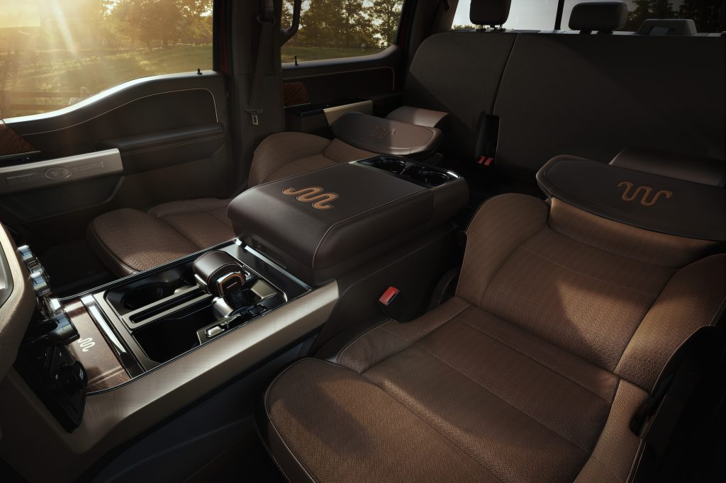 A 2021 Ford F-150 King Ranch pickup truck's tan front seats reclined flat