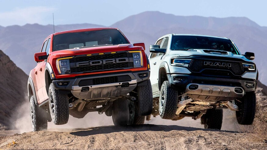 The 2021 Ford Raptor beside the 2021 Ram 1500 TRX.