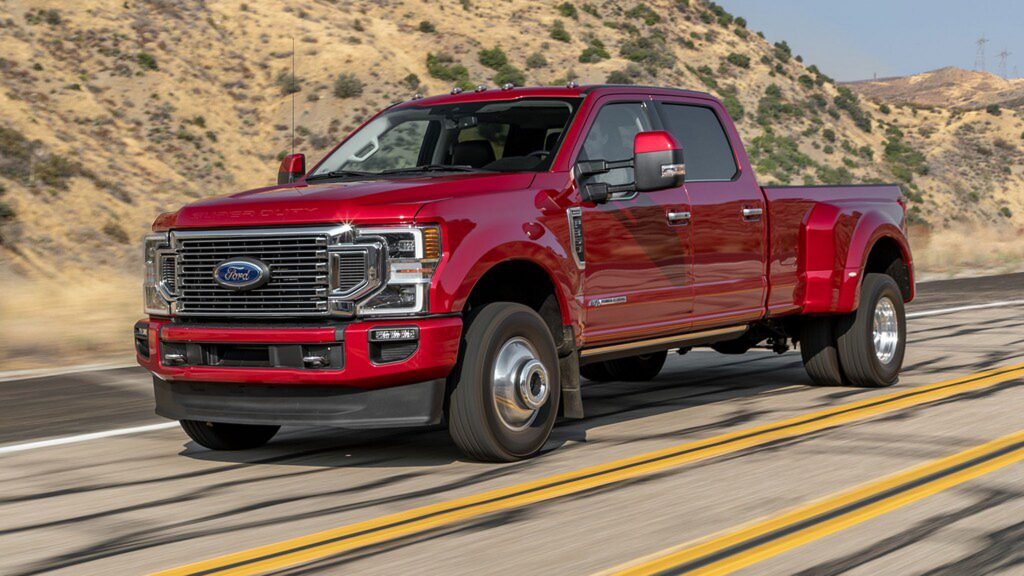 The 2021 Ford F-350 Super Duty truck driving down the road
