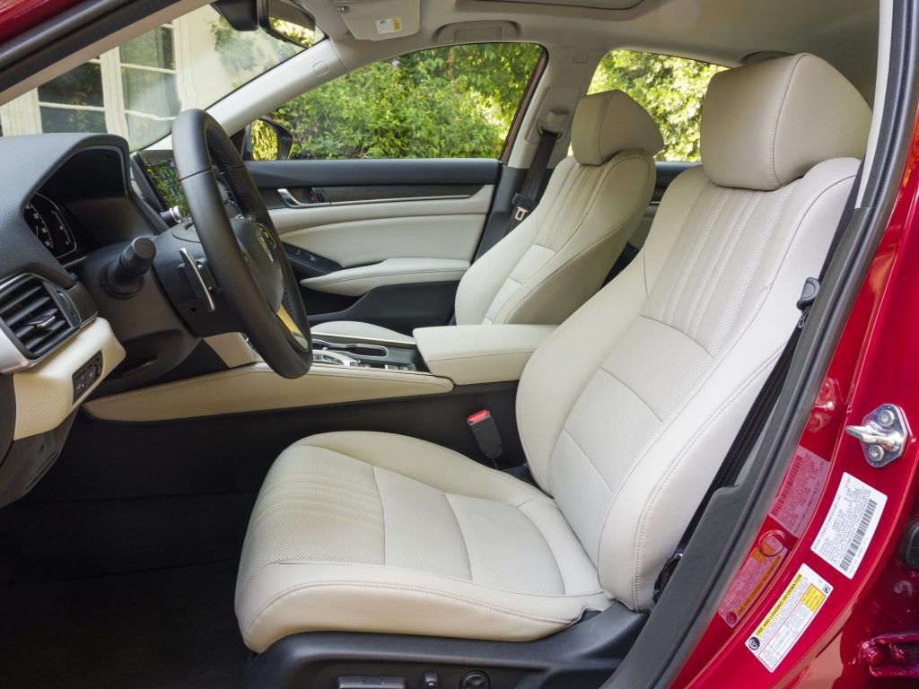 A look at the white leather seats inside of a red 2021 Honda Accord Hybrid