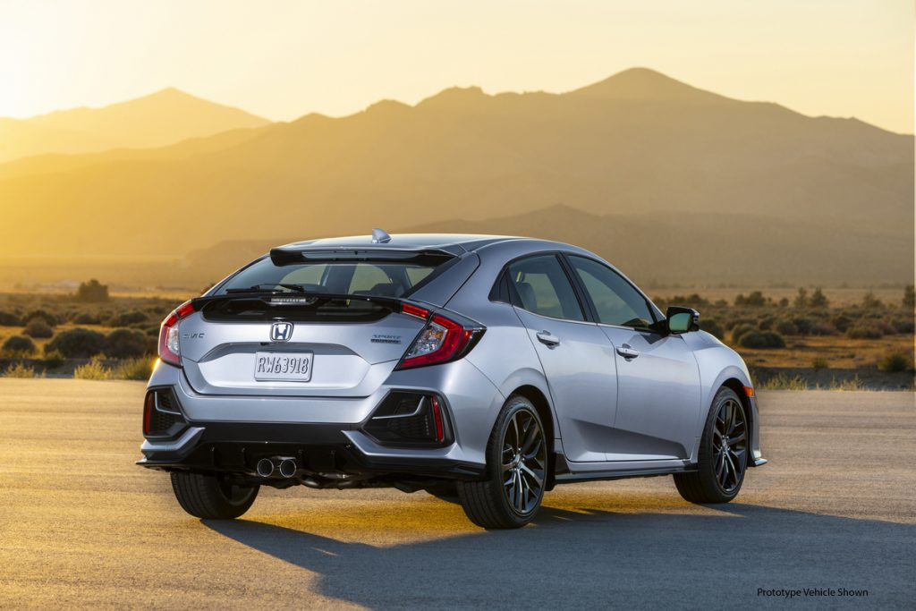 a rear shot of the 2021 Honda Civic Hatchback Sport Touring in the sunset