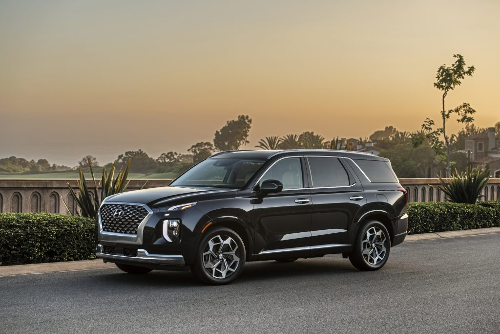 2021 Hyundai Palisade Calligraphy parked on display with a dusk sky in the background