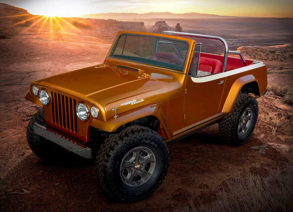 The orange 2021 Jeep Jeepster Beach concept in the desert mountains