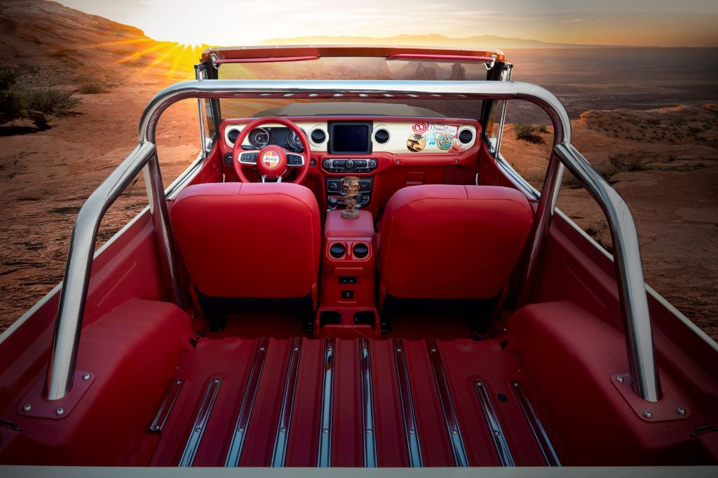 The rear view of the 2021 Jeep Jeepster Beach conept's chrome roll cage and red-leather interior