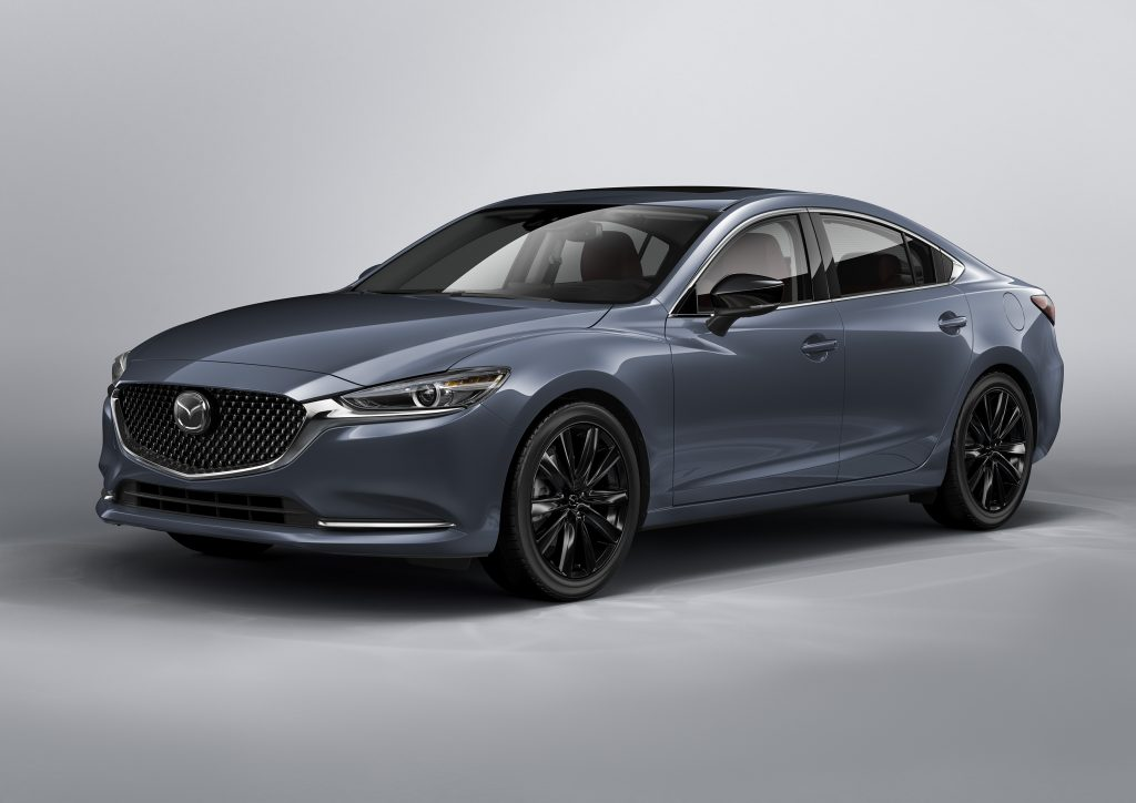 A grey 2021 Mazda6 Carbon Edition on display in front of a silver background