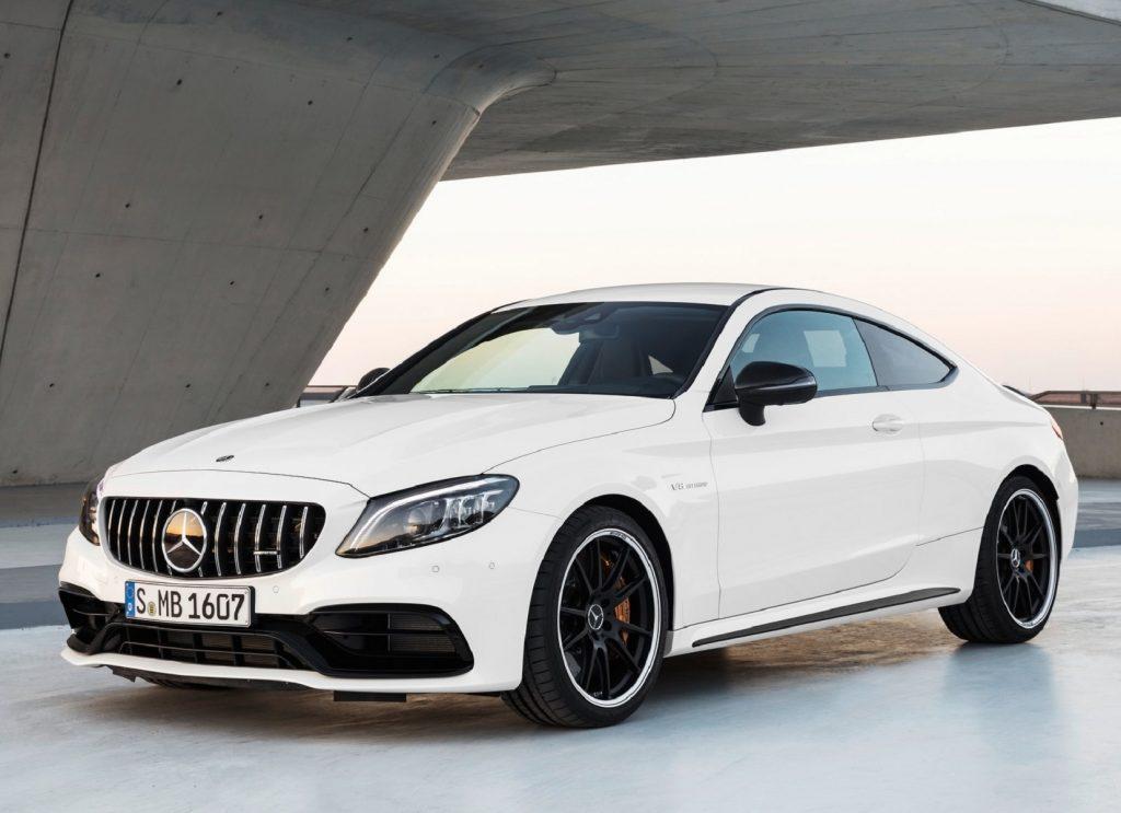 A white 2021 Mercedes-AMG C 63 S Coupe underneath a concrete structure
