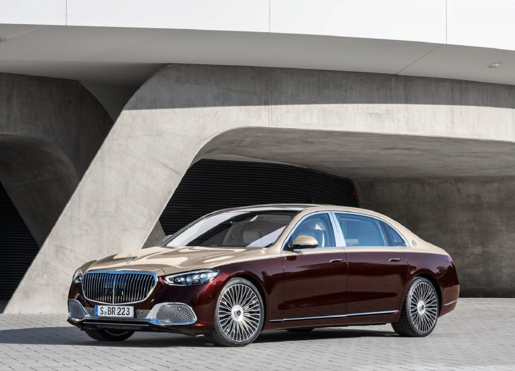 A two-tone gold-and-maroon 2021 Mercedes-Maybach S-Class in front of a concrete building