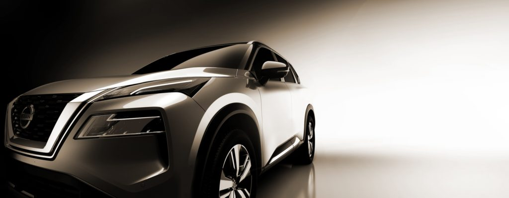 A silver 2021 Nissan Rogue against a neutral background