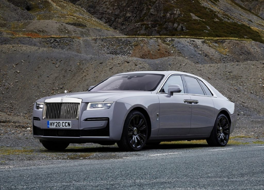 The side 3/4 view of a gray 2021 Rolls-Royce Ghost in a quarry