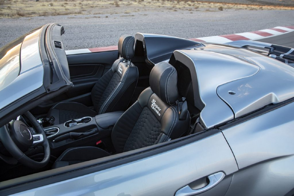 The embroidered black-leather seats of a silver-with-black-stripes 2021 Shelby Super Snake Speedster