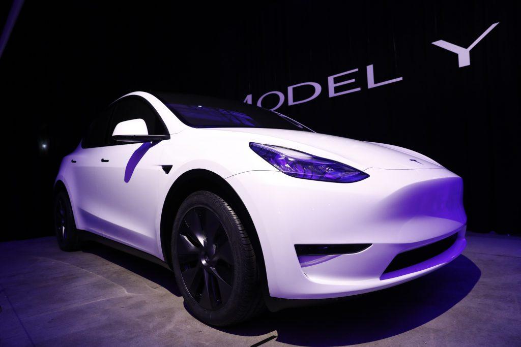 A white 2021 Tesla Model Y on display