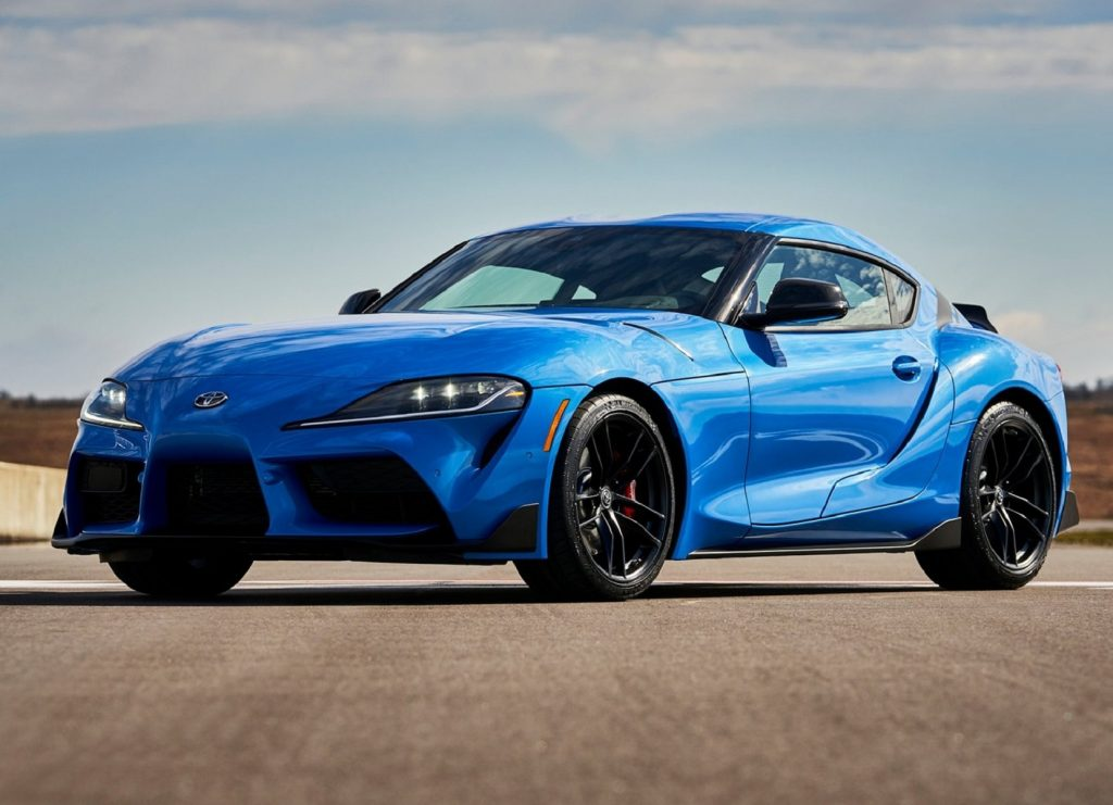 A blue 2021 Toyota GR Supra 3.0 parked on a racetrack