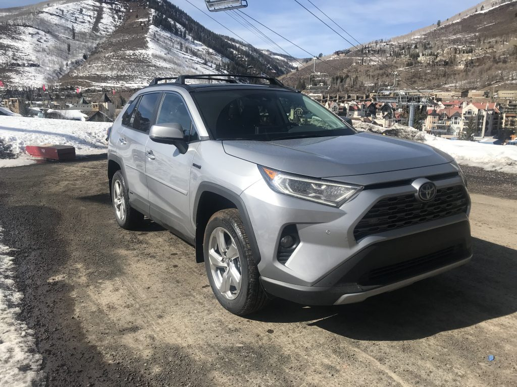 a front shot of the 2021 Toyota RAV4 Hybrid next to a ski slope