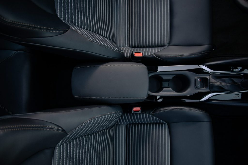 Black leather and stripe interior of the 2011 Toyota Camry