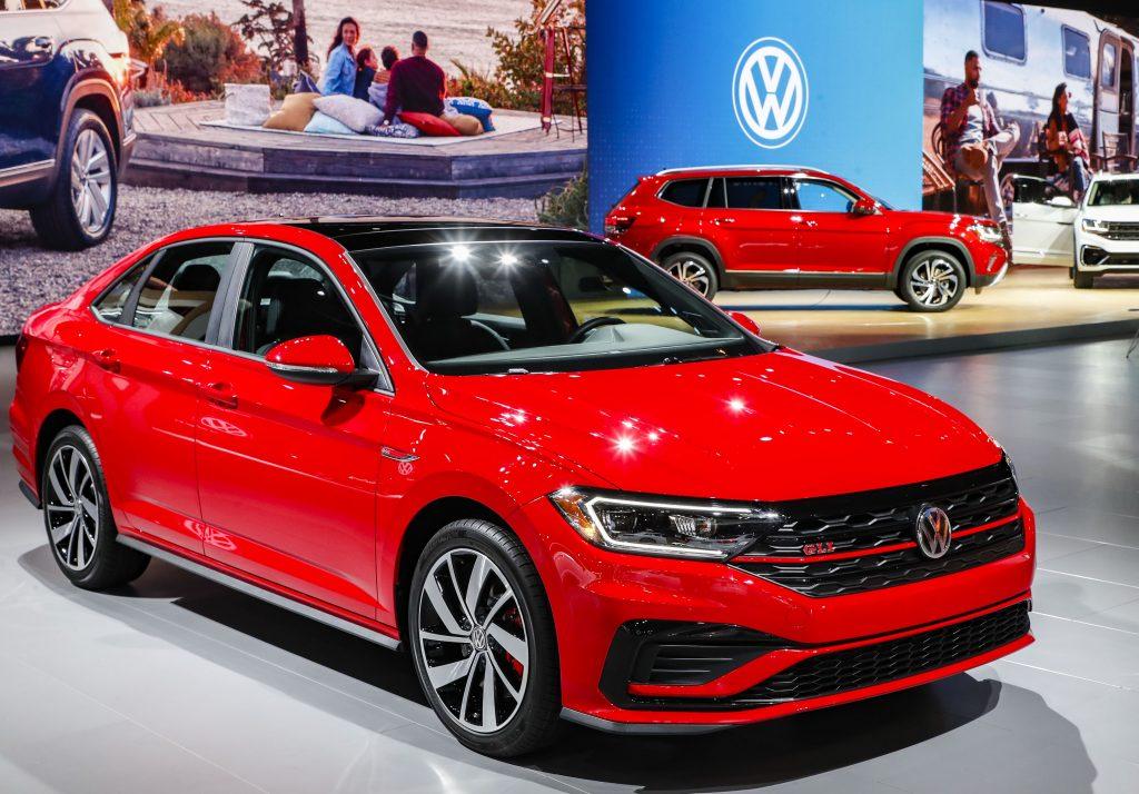 A red 2021 Volkswagen Jetta on display