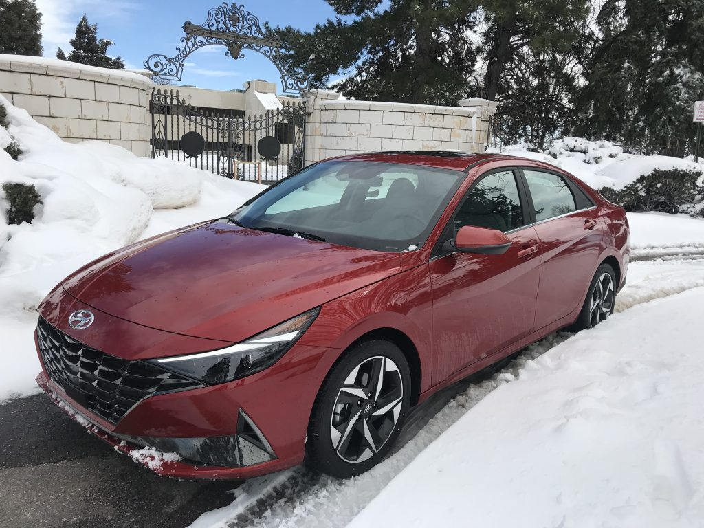 2021 Hyundai Elantra sits in front of a snow-covered gate