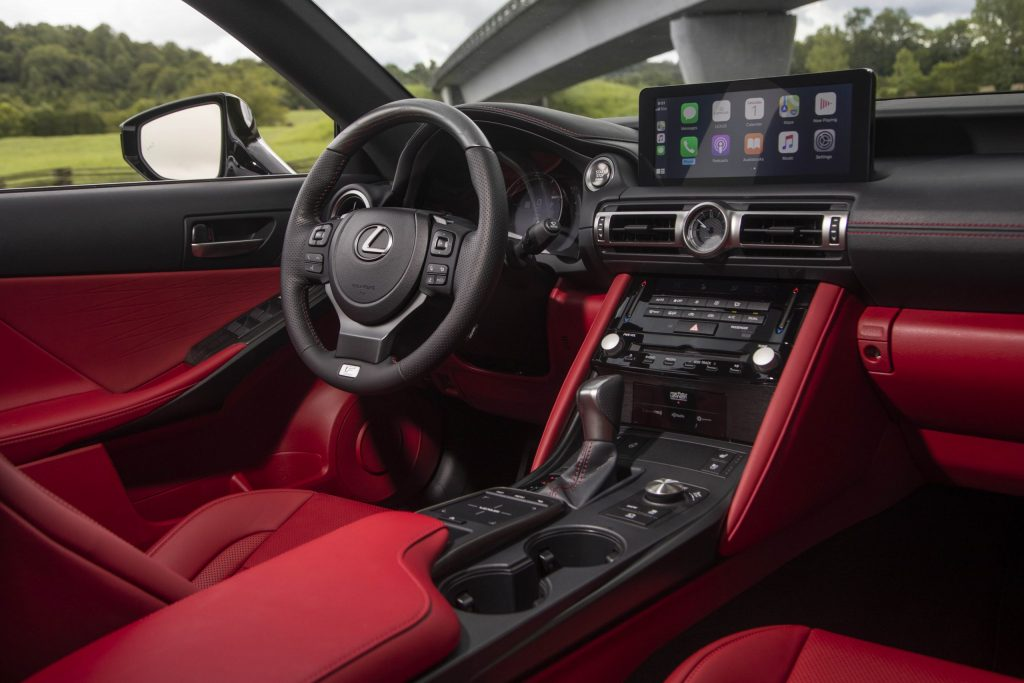 The luxurious red and black leather interior of the 2021 Lexus IS