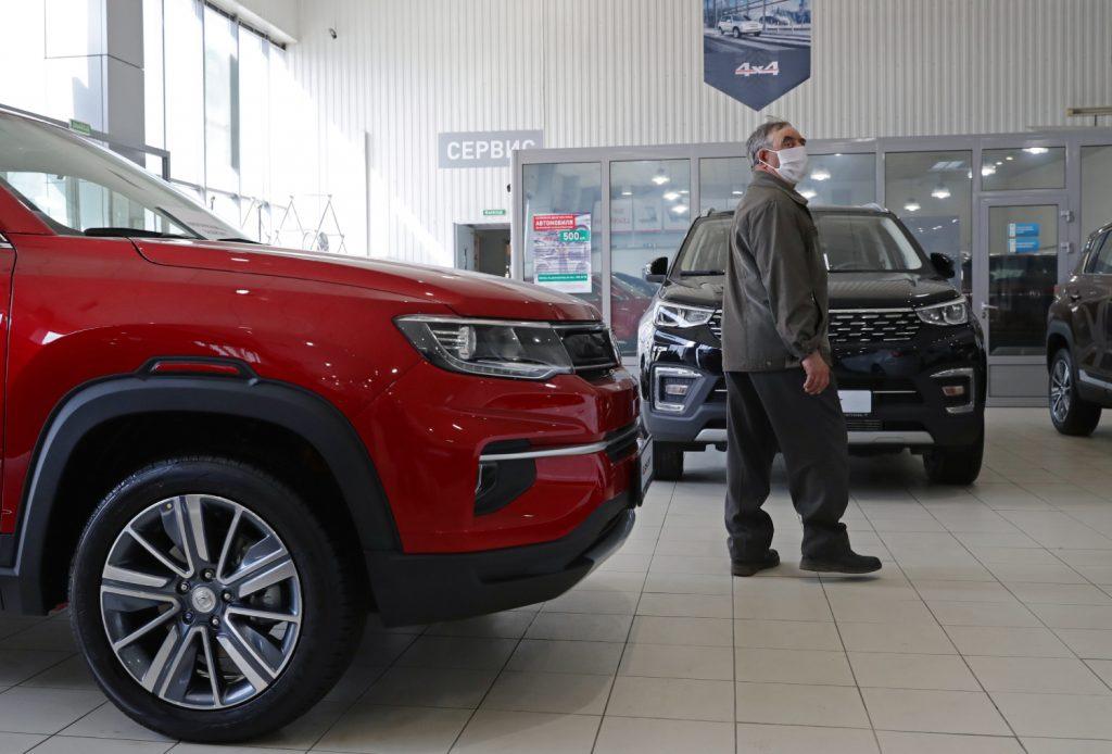 A potential customer browses cars at a car dealership