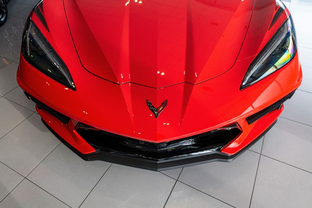 A red 2021 Chevrolet Corvette on display at a dealership