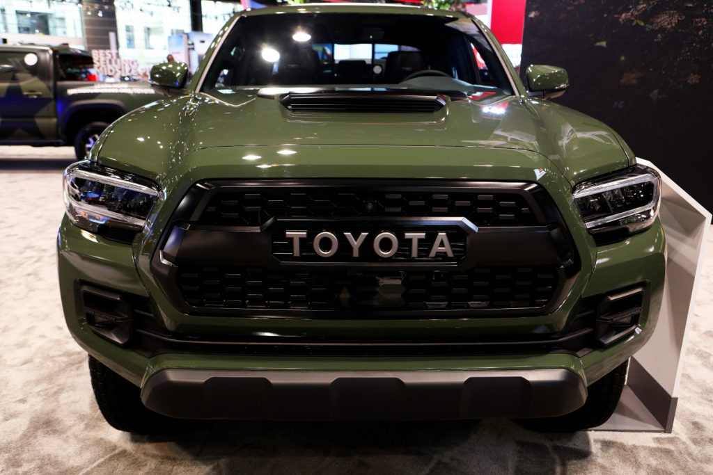 A green Toyota Tacoma with the TRD Pro grille style on display