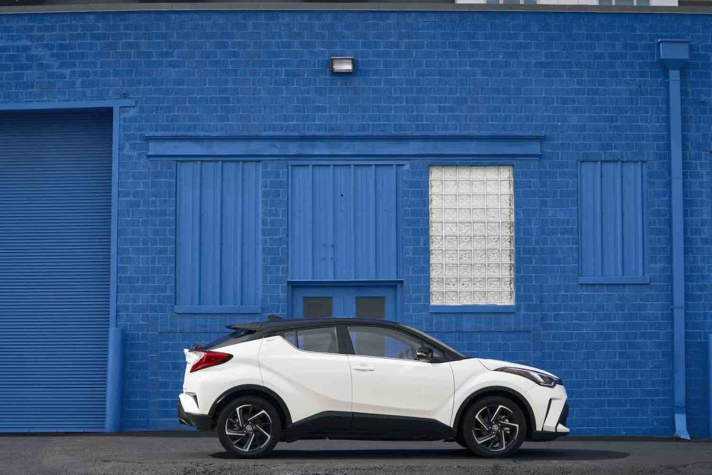 2021 Toyota C-HR parked in front of a blue wall