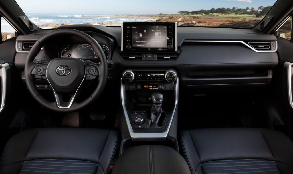 The 2021 Toyota RAV4 Hybrid interior shot from the front seat