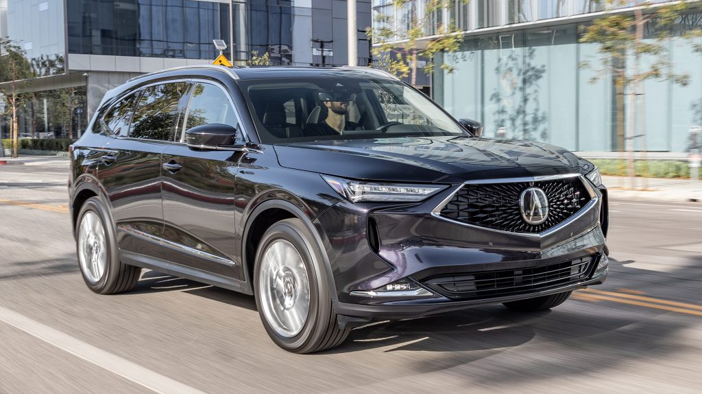 The 2022 Acura MDX driving through a city